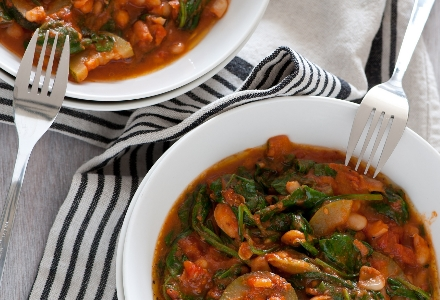 vegetable and bean stew with forks in bowls