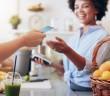 bigstock-Juice-Bar-Owner-Taking-Payment-133993991-653x339.jpg