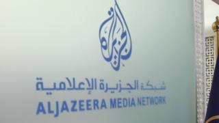 The Al Jazeera Media Network logo is seen inside its headquarters in Doha, Qatar June 8, 2017