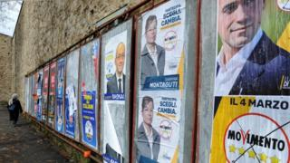 Election posters for Italian political parties on a wall in Florence, Italy on 4 March