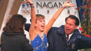 Tara Lipinski of the USA reacts as her scores flash on the screen during the free skate competition at White Ring Arena during the 1998 Winter Olympic Games in Nagano, Japan.