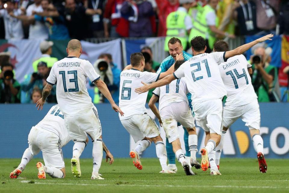 The Russian team pile on the hero Akinfeev