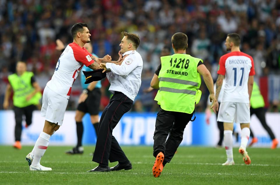Lovren pushes the protester to the floor