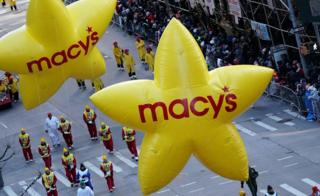 Macy's balloons are carried down 6th Avenue during the 92nd Macy's Thanksgiving Day Parade in New York City, November 22, 2018
