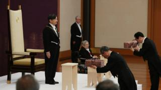 "Japan""s Emperor Naruhito, flanked by Prince Hitachi, attends a ritual called Kenji-to-Shokei-no-gi"