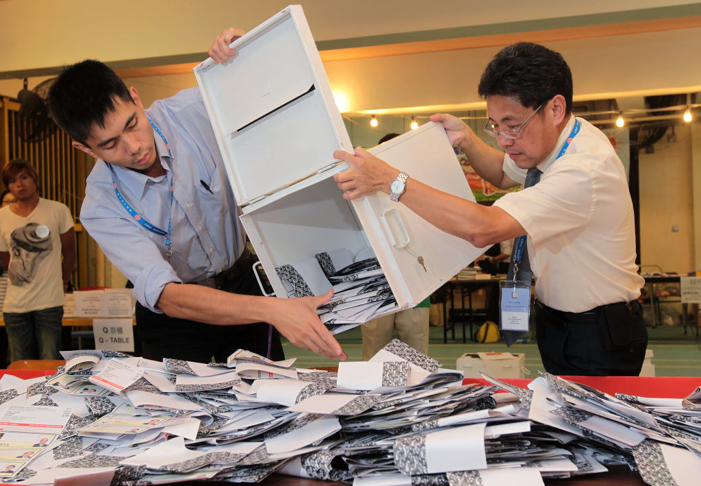 Election officials empty ballot boxes to count votes in Hong Kong (2011)