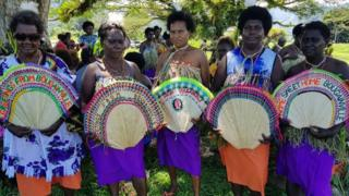 Women in tribal colours attend a Bougainville reconciliation ceremony