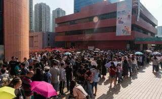 People line up at a polling station to vote in the Tuen Man District Council elections on November 24, 2019 in Hong Kong