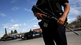 Federal police officer armed and on guard in northern Mexico