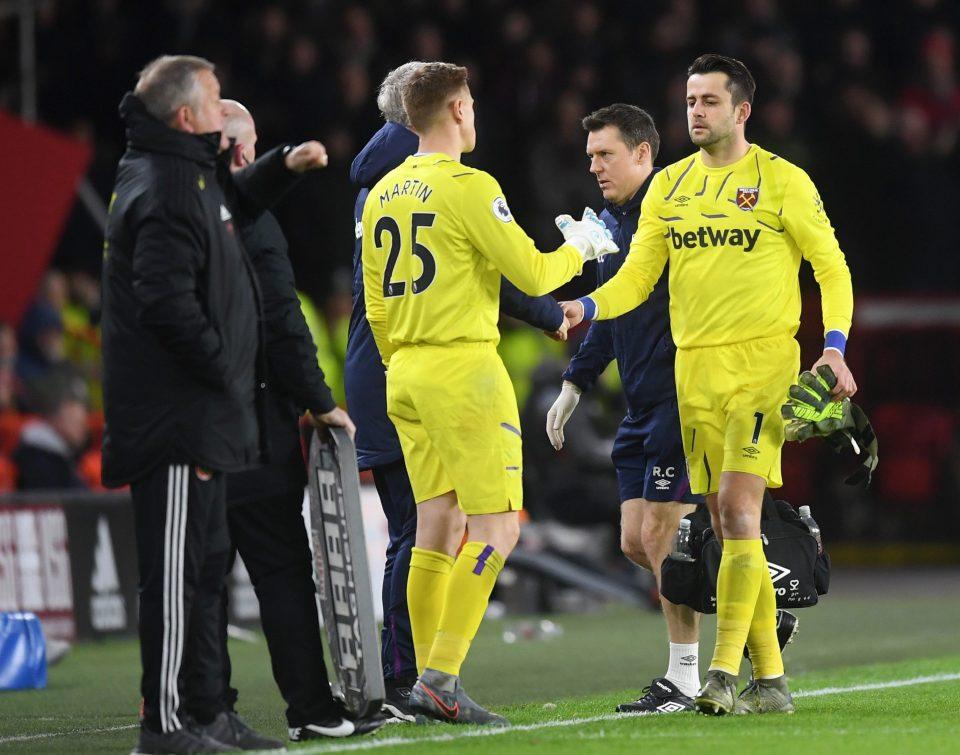David Martin replaced Lukasz Fabianski after just 15 minutes
