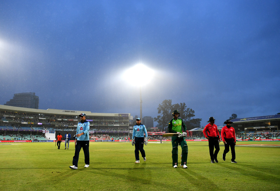 England players leave the pitch following poor weather conditions during the second ODI