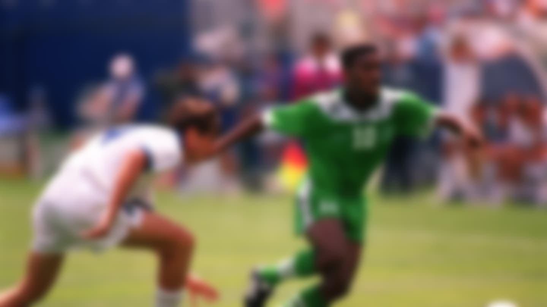 Nigeria's Jay Jay Okocha dribbles past Italy's Alessandro Costacurta
