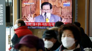 People watch a TV broadcasting a news report on a news conference held by Lee Man-hee, founder of the Shincheonji Church of Jesus the Temple of the Tabernacle of the Testimony, in Seoul, South Korea, March 2, 2020