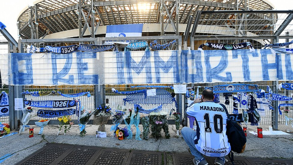 An SSC Napoli fan in mourning for Maradona