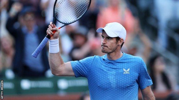 Andy Murray raises his racquet